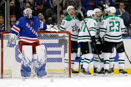 New York Rangers goaltender Henrik Lundqvist (30) reacts as the Dallas Stars celebrate a goal by Blake Comeau during the second period of an NHL hockey game, in New York