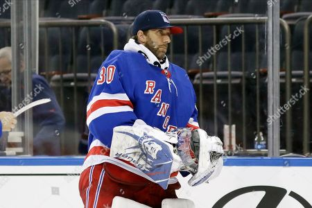New York Rangers goaltender Henrik Lundqvist (30) leaves the ice after an NHL hockey game against the Dallas Stars, in New York. The Stars won 5-3