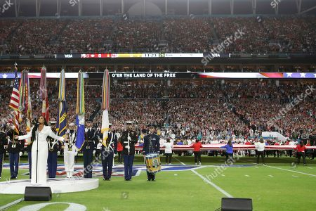 Stock Photo of Demi Lovato sings the national anthem before Super Bowl 54, in Miami Gardens, Fla