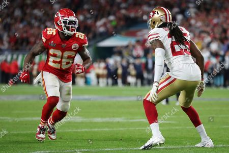 Kansas City Chiefs running back Damien Williams (26) runs off the line while San Francisco 49ers cornerback Richard Sherman (25) covers him during the second half of the NFL Super Bowl 54 football game between the San Francisco 49ers and Kansas City Chiefs, in Miami Gardens, Fla. The Kansas City Chiefs won 31-20