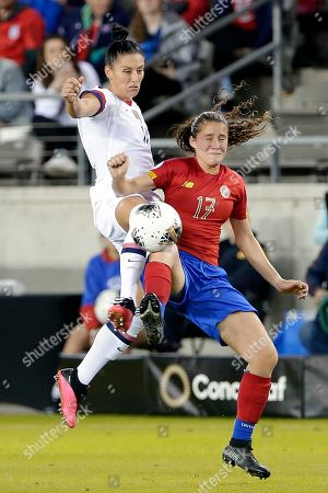 United States defender Ali Krieger (11) and Costa Rica forward Maria Salas (17) collides as they both try to bring down the ball during the second half of a Concacaf women's Olympic qualifying soccer match, in Houston