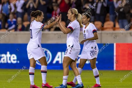United States forward Carli Lloyd (10) in celebration high fives of midfielder Lindsey Horan (9) after her goal in the first half during the CONCACAF Group A Women's Olympic Qualifying match against the Costa Rica at BBVA Stadium in Houston, Texas