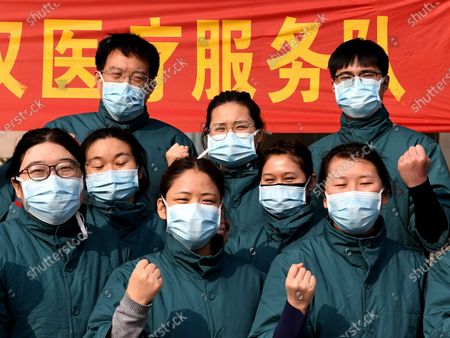 Liu Guangyao (1st R, back) and Qiao Bing (2nd R, back) pose for a group photo with their teammates before setting off for Wuhan in Hubei Province, in Zhengzhou, central China's Henan Province. Liu Guangyao and Qiao Bing, both medical workers born in the 1990s, have been in love for more than 2 years. During the outbreak of coronavirus, they signed up for the medical team to aid the coronavirus control efforts in Hubei. Before setting off, they cheered for each other and promised to get married once they come back to Henan.