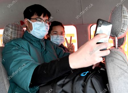 Liu Guangyao (front) and Qiao Bing take a selfie before setting off for Wuhan in Hubei Province, in Zhengzhou, central China's Henan Province. Liu Guangyao and Qiao Bing, both medical workers born in the 1990s, have been in love for more than 2 years. During the outbreak of coronavirus, they signed up for the medical team to aid the coronavirus control efforts in Hubei. Before setting off, they cheered for each other and promised to get married once they come back to Henan.