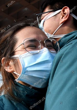 Liu Guangyao (R) hugs Qiao Bing before setting off for Wuhan in Hubei Province, in Zhengzhou, central China's Henan Province. Liu Guangyao and Qiao Bing, both medical workers born in the 1990s, have been in love for more than 2 years. During the outbreak of coronavirus, they signed up for the medical team to aid the coronavirus control efforts in Hubei. Before setting off, they cheered for each other and promised to get married once they come back to Henan.
