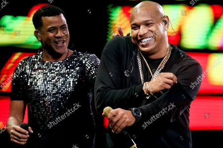 """Randy Malcom Martinez and Alexander Delgado of the Cuban duo """"Gente de Zona"""" perform during the Vina del Mar International Song Festival at the Quinta Vergara coliseum in Vina del Mar, Chile. Platinum-selling reggaeton act Gente de Zona were barred from a New Year's Eve concert in a Miami park on Dec. 31, 2019. As President Donald Trump tightens the trade embargo on Cuba, some members of the United States' largest Cuban-American community are once again taking a hard line on performers like Gente de Zona who support its communist government or don't speak out against it"""