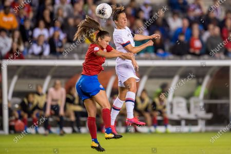 United States forward Carli Lloyd (10) heads the ball past Costa Rica defender Fabiola Sanchez (5) during the 1st half of a CONCACAF Olympic Qualifying soccer match between Costa Rica and the United States of America at BBVA Stadium in Houston, TX. The United States won the game 6 to 0