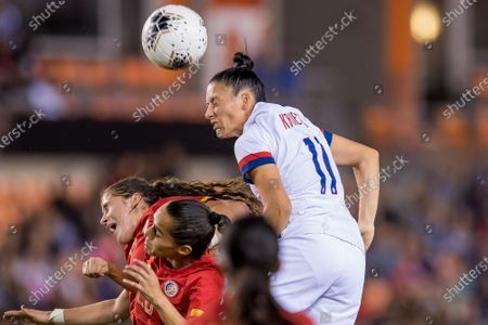 United States defender Ali Krieger (11) heads the ball during the 2nd half of a CONCACAF Olympic Qualifying soccer match between Costa Rica and the United States of America at BBVA Stadium in Houston, TX. The United States won the game 6 to 0