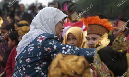 Singaporean President Halimah Jacob (L) accompanied greets children at the Bogor Palace in Bogor, Indonesia, 04 February 2020.