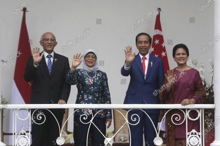 Stock Picture of President of Singapore Halimah Jacob (2-L), her husband Mohamed Abdullah Alhabshee (L), Indonesian President Joko Widodo (2-R) and his wife Iriana Joko Widodo (R) wave to journalists during a meeting at the Bogor Palace in Bogor, Indonesia, 04 February 2020.
