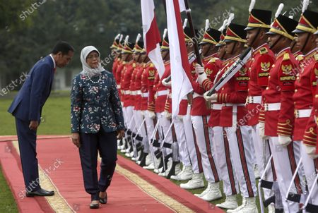 Singaporean President Halimah Jacob (C) accompanied by Indonesian President Joko Widodo (L) inspects an honor guard at the Bogor Palace in Bogor, Indonesia, 04 February 2020.
