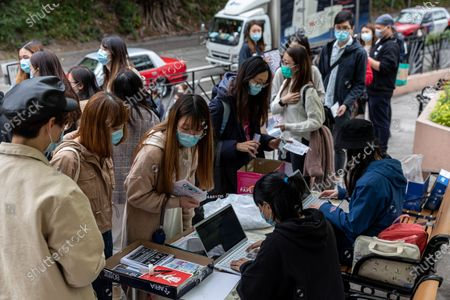 Members of the Hospital Authority Employees Alliance queue to sign up for a strike in Hong Kong, China, 04 February 2020. The alliance is pressing the government for a complete border shutdown in order to prevent the spread of the coronavirus outbreak. Hong Kong reported its first death linked to the coronavirus after a 39-year-old man died from the illness at Princess Margaret Hospital.