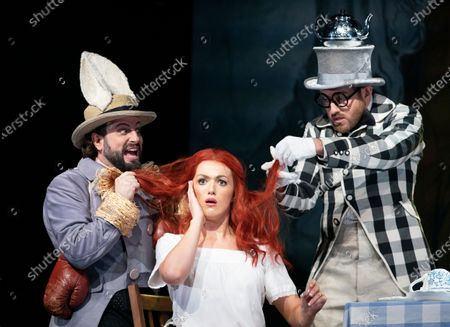 Peter Tansits as March Hare, Claudia Boyle as Alice, Sam Furness as Mad Hatter