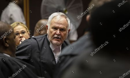 Stock Photo of Barry Roux (C), new senior council to South Africa's former president Jacob Zuma, appears at the Pietermaritzburg High Court in Pietermaritzburg, South Africa, 04 February 2020. Former President Zuma did not appear due to illness. Former president Zuma stands accused of taking kickbacks before he became president from a 51 billion rand (3.4 billion US dollar) purchase of fighter jets, patrol boats and military equipment manufactured by five European firms, including French defence company Thales.