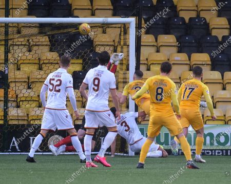 Aaron Taylor-Sinclair of Livingston heads home the only goal of the game