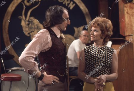 Jeremy Young (as Benny Lewis) and Barbara Knox (as Rita Littlewood)
