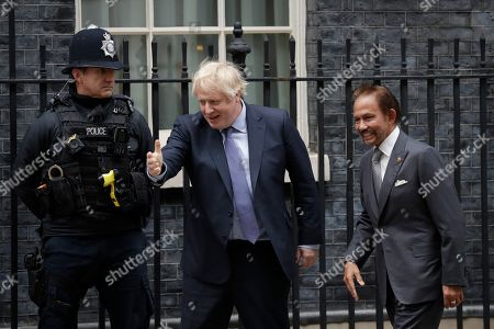 British Prime Minister Boris Johnson walks with the Sultan of Brunei, Hassanal Bolkiah as he greets him before their meeting at 10 Downing Street in London