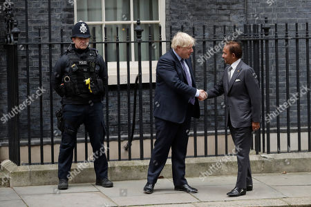 British Prime Minister Boris Johnson greets the Sultan of Brunei, Hassanal Bolkiah before their meeting at 10 Downing Street in London