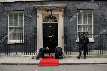 The red carpet is laid out before the arrival of the Sultan of Brunei Hassanal Bolkiah for his meeting with British Prime Minister Boris Johnson at 10 Downing Street in London