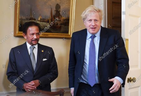 British Prime Minister Boris Johnson (R) and the Sultan of Brunei Hassanal Bolkiah (L) sit for a meeting in 10 Downing Street in London, Britain, 04 February 2020.