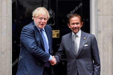 Stock Image of Sultan of Brunei is greeted by Boris Johnson, ahead of talks in Number 10 Downing Street.