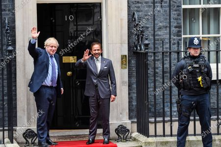Stock Picture of Sultan of Brunei and Boris Johnson, wave to the media ahead of talks in Number 10 Downing Street.