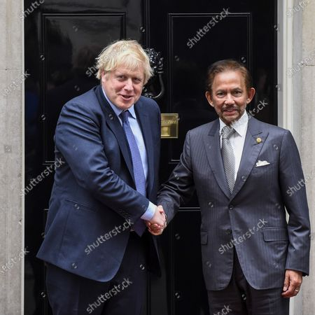 Stock Photo of Sultan of Brunei is greeted by Boris Johnson, ahead of talks in Number 10 Downing Street.
