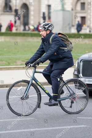 Jeremy Hunt leaves Parliament on his bicycle.