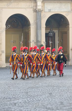 Guards march outside the Vatican.