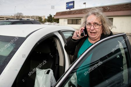 Julie Wright. Julie Stewart, precinct captain in Waukee, Iowa, arrives at the Iowa Democratic Party headquarters in Des Moines, Iowa, with her precinct's caucus preference cards, only to find the building unoccupied