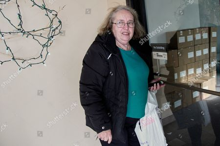Stock Image of Julie Wright. Julie Stewart, precinct captain in Waukee, Iowa, arrives to the Iowa Democratic Party headquarters in Des Moines, Iowa, with her precinct's caucus preference cards, only to find the building unoccupied