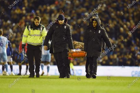 Josh McEachran of Birmingham City is carried off the field after an injury.