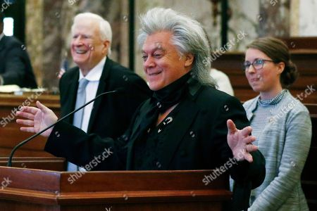 Stock Image of Country and rockabilly music star Marty Stuart acknowledges the applause from members of the Senate at the Capitol in Jackson, Miss., . Stuart, a Philadelphia, Miss., native, was recognized by lawmakers for his achievements as a Grammy award winning musician, singer and songwriter and his commitment to Mississippi