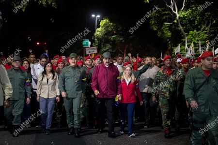 The Venezuelan president, Nicolas Maduro (C), heads with his wife, Cilia Flores (C-R), a march that left before dawn (about 10.00 GMT) to the Barracks Mountain to honor the attempted coup of 1992 led by the late former Venezuelan President Hugo Chavez (1999-2013), in Caracas, Venezuela 04 February 2020.