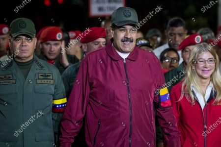 The Venezuelan president, Nicolas Maduro (C), heads with his wife, Cilia Flores (R), a march that left before dawn (about 10.00 GMT) to the Barracks Mountain to honor the attempted coup of 1992 led by the late former Venezuelan President Hugo Chavez (1999-2013), in Caracas, Venezuela 04 February 2020.