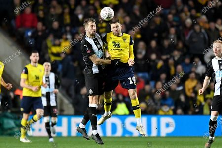 Oxford United forward Jamie Mackie (19) battles for possession  wirth Newcastle United defender Florian Lejeune (20) during the The FA Cup match between Oxford United and Newcastle United at the Kassam Stadium, Oxford