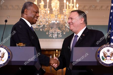 Mike Pompeo, Geoffrey Onyeama. Nigeria's Minister of Foreign Affairs Geoffrey Onyeama, left, shakes hands with Secretary of State Mike Pompeo, at the State Department in Washington