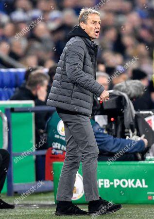Berlin's head coach Juergen Klinsmann reacts during the German soccer cup, DFB Pokal, match between FC Schalke 04 and Hertha BSC Berlin in Gelsenkirchen, Germany