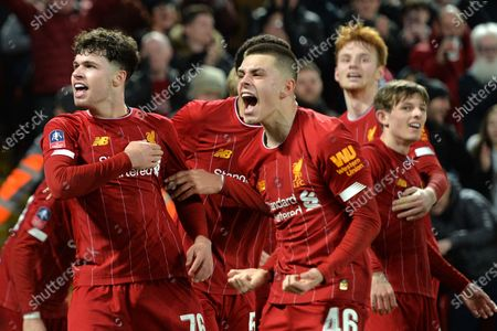 Liverpool players Adam Lewis (C) and Neco Williams (L) celebrate after going 1-0 up through an own-goal of Shrewsbury during the English FA Cup fourth round replay match between Liverpool FC and Shrewsbury Town FC in Liverpool, 04 February 2020.