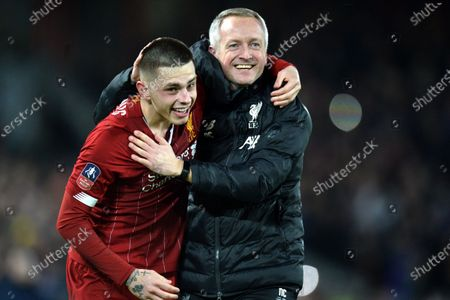Liverpool under-23s manager Neil Critchley (R) and player Adam Lewis celebrate after the English FA Cup fourth round replay match between Liverpool FC and Shrewsbury Town FC in Liverpool, 04 February 2020. Liverpool won 1-0.