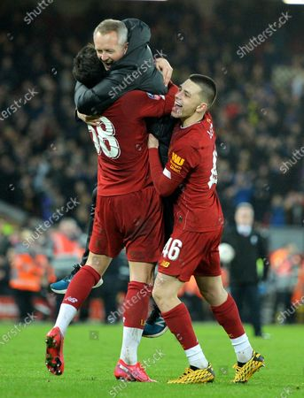 Liverpool under-23s manager Neil Critchley (C) and players Adam Lewis (R) and Pedro Chirivella celebrate after the English FA Cup fourth round replay match between Liverpool FC and Shrewsbury Town FC in Liverpool, 04 February 2020. Liverpool won 1-0.