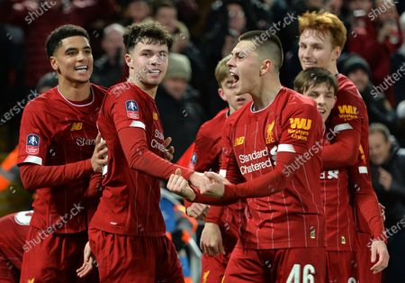 Liverpool players Adam Lewis (C) and Neco Williams (2L) celebrate with teammates after going 1-0 up through an own-goal of Shrewsbury during the English FA Cup fourth round replay match between Liverpool FC and Shrewsbury Town FC in Liverpool, 04 February 2020. Liverpool won 1-0.