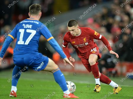 Adam Lewis (R) of Liverpool in action against Donald Love of Shrewsbury during the English FA Cup fourth round replay match between Liverpool FC and Shrewsbury Town FC in Liverpool, 04 February 2020.
