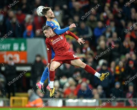 Adam Lewis (front) of Liverpool in action against Callum Lang of Shrewsbury during the English FA Cup fourth round replay match between Liverpool FC and Shrewsbury Town FC in Liverpool, 04 February 2020.
