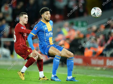Adam Lewis (L) of Liverpool in action against Josh Laurent of Shrewsbury during the English FA Cup fourth round replay match between Liverpool FC and Shrewsbury Town FC in Liverpool, 04 February 2020.