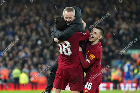 Liverpool's Under 23 coach Neil Critchley, center, celebrates with Liverpool's Pedro Chirivella and Liverpool's Adam Lewis, right, after winning the English FA Cup Fourth Round replay soccer match between Liverpool and Shrewsbury Town at Anfield Stadium, Liverpool, England, . Liverpool won 1-0