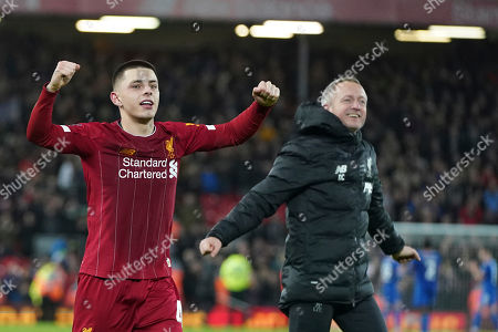 Stock Photo of Liverpool's Under 23 coach Neil Critchley, right, celebrates with his player Adam Lewis after winning the English FA Cup Fourth Round replay soccer match between Liverpool and Shrewsbury Town at Anfield Stadium, Liverpool, England, . Liverpool won 1-0