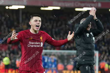 Liverpool's Adam Lewis celebrates with Liverpool's Under 23 coach Neil Critchley, right, after winning the English FA Cup Fourth Round replay soccer match between Liverpool and Shrewsbury Town at Anfield Stadium, Liverpool, England, . Liverpool won 1-0