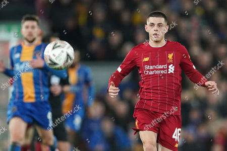 Liverpool's Adam Lewis eyes the ball during the English FA Cup Fourth Round replay soccer match between Liverpool and Shrewsbury Town at Anfield Stadium, Liverpool, England