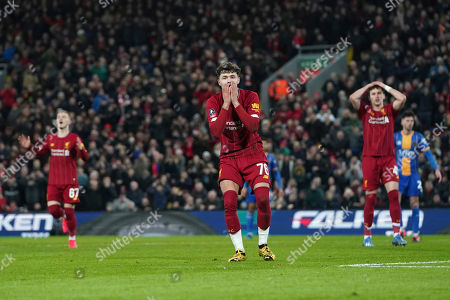 Liverpool's Harvey Elliott, left, Liverpool's Neco Williams, center, and Liverpool's Adam Lewis react after a missed scoring opportunity during the English FA Cup Fourth Round replay soccer match between Liverpool and Shrewsbury Town at Anfield Stadium, Liverpool, England